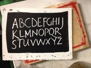 Woodblock alphabet, cut in reverse. Printed letterpress.