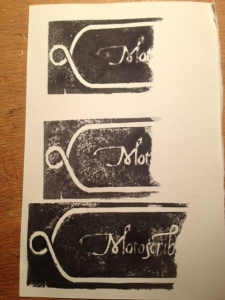 Three separate proofs at different stages of cutting the logo