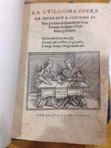 Verini teaches a woman to write. Newberry Library.